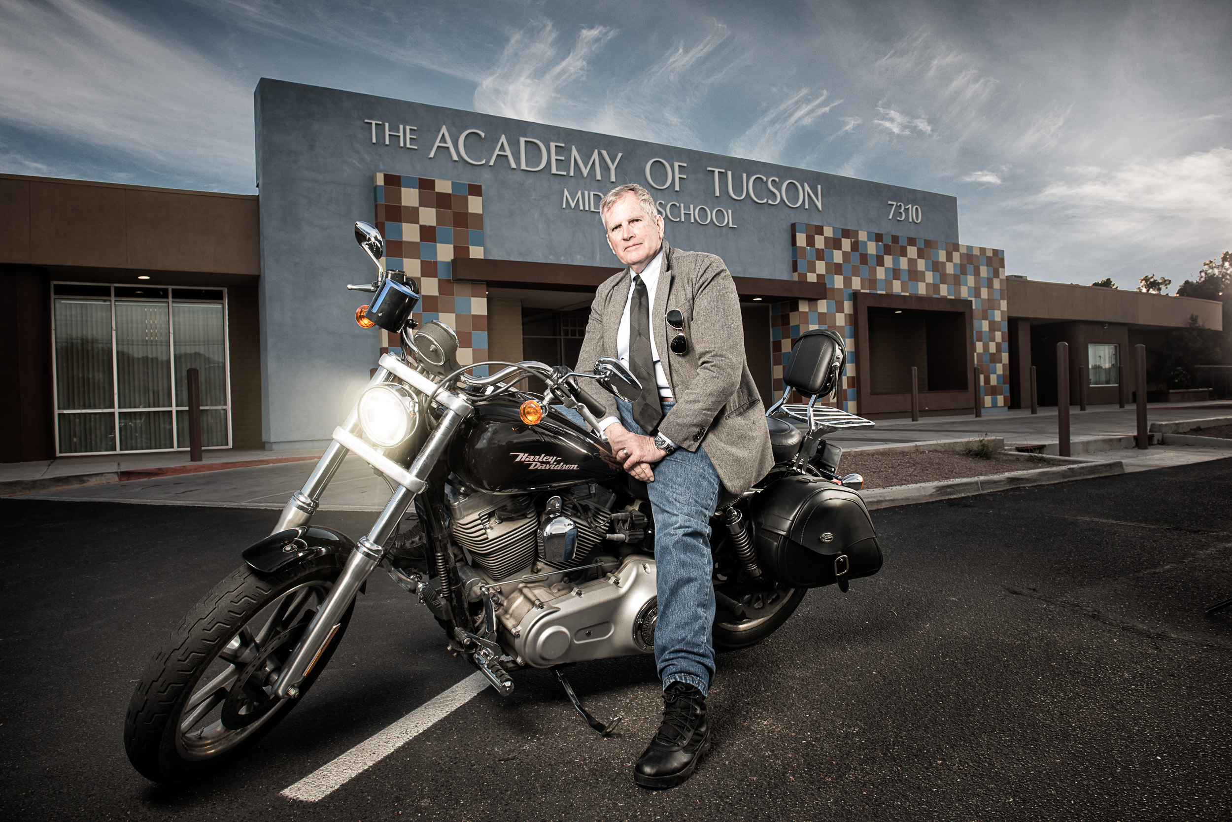 Environmental portrait of award winning history teacher, Richard Moore on his beloved Harley Davidson.