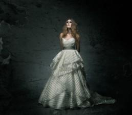 Dark fashion portraits of Kayla De Rosa shot in the studio by Paul Davis Photography, Tucson, Arizona. White wedding dress provided by J. Bridal Boutique.